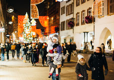 PEople having fun during Christmas market on Rue des Grandes Arc Stock Photography