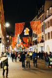 PEople having fun during Christmas market on Rue des Grandes Arc Stock Photo
