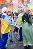 People having fun on city carnival. Royalty Free Stock Images