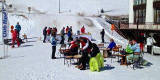 Apres ski at Club Med. People having fun in Club Med's Apres ski in the Alps, France royalty free stock photo