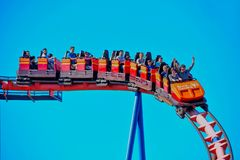People having fun in colorful vintage rollercoaster 80`s style at Bush Gardens Tampa Bay Theme Park stock photos