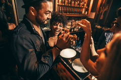 People having fun with drinks at nightclub Stock Images