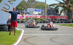 People having fun on a go cart. Finish line Royalty Free Stock Images