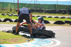 People having fun on a go cart. Out of track help Royalty Free Stock Photos