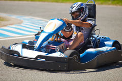 People having fun on a go cart. Summer season Stock Images