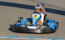 People having fun on a go cart. Thumb up boy Stock Photography
