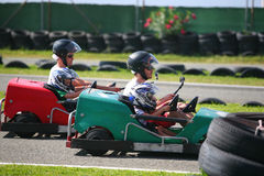People having fun on a go cart. Video camera recorders Royalty Free Stock Images