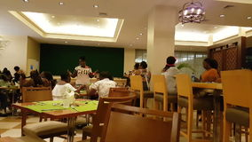 People having a fun inside a resort restaurant dancing in Panama stock video