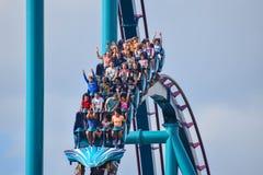 People having fun Mako Rollercoaster on lightblue cloudy sky bakcground at Seaworld 5 stock photography