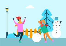 People Having Fun Outdoors, Girl with Ball of Snow. People having fun outdoors, girl with huge ball of snow and merry boy, snowman wth bucket near Christmas tree Royalty Free Stock Photography