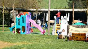 People having fun at the park outdoor in a sunny day. Rocca Priora, Italy - April 2018: People having fun at the park outdoor in a sunny day stock video footage