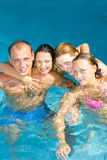 People having fun in a pool Royalty Free Stock Photos