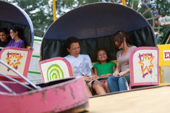 People Having Fun On Ride At County Fair Stock Image