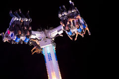 People having fun in a roller coaster at night Royalty Free Stock Photography