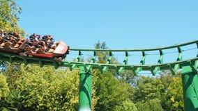 People having fun at roller coaster stock video