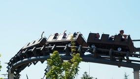 People having fun at roller coaster stock video footage