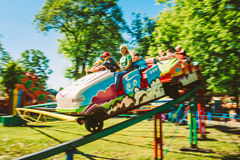 People Having Fun On Rollercoaster In The Park Stock Image