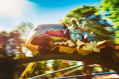 People Having Fun On Rollercoaster In The Park Royalty Free Stock Image