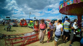 People having fun in a Romanian country fair Royalty Free Stock Photo