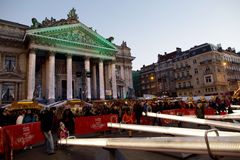 People having fun in the seesaws in from of Stock exchange at the Winter Wonders in Brussels Royalty Free Stock Photo