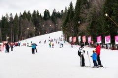 People Having Fun Skiing On Snowy Mountain Royalty Free Stock Photo