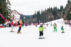 People Having Fun Skiing On Snowy Mountain Stock Image