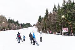 People Having Fun Skiing On Snowy Mountain Royalty Free Stock Image