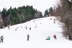 People Having Fun Skiing On Snowy Mountain Royalty Free Stock Photography