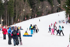 People Having Fun Skiing On Snowy Mountain Royalty Free Stock Photography