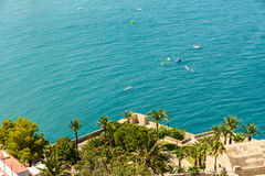 People Having Fun In Small Boats And Surf Paddle Boards On The Mediterranean Sea Royalty Free Stock Photos
