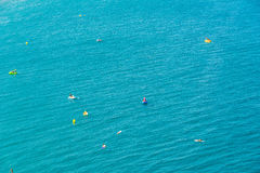 People Having Fun In Small Boats And Surf Paddle Boards On The Mediterranean Sea Royalty Free Stock Image
