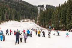 People Having Fun On Snowy Mountain Sky Resort Stock Images