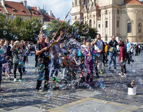 People having fun with soap bubbles at Old Town Square, Prague,. Prague, Czech Republic - September 23, 2016: unidentified having fun with soap bubbles at Old royalty free stock images