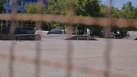 People having fun in the summer skate Park on bycicles stock video
