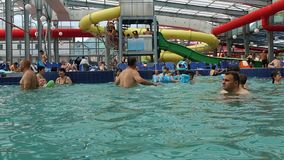 People having fun in swimming pool, hyperlapse pan and zoom out. Hd video stock footage
