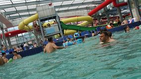 People having fun in swimming pool, hyperlapse, zoom out. Hd video stock video