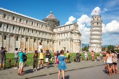 People having fun and taking pictures of the leaning tower of Pisa in Tuscany Italy Royalty Free Stock Photo