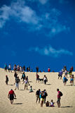 People having fun walking up on one of the biggest dune of Europe, Pyla, Pilat, France Stock Photos