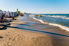 People Having Fun In Water And Relaxing In Mamaia Beach Resort At The Black Sea In Romania Stock Photo