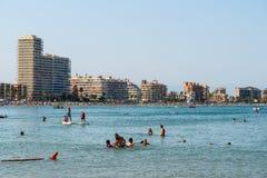 People Having Fun In Water And Relaxing In Peniscola Beach Resort At Mediterranean Sea In Spain Royalty Free Stock Image