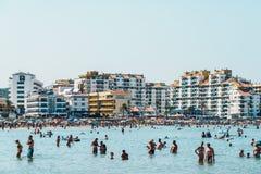 People Having Fun In Water And Relaxing In Peniscola Beach Resort At Mediterranean Sea In Spain Stock Photos