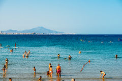 People Having Fun In Water And Relaxing In Peniscola Beach Resort At Mediterranean Sea In Spain Royalty Free Stock Images
