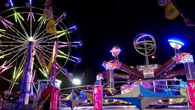 People having fun at the West Coast Amusements Carnival stock footage