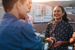 People having good time at rooftop party Royalty Free Stock Image