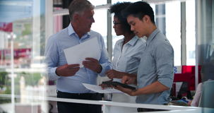 People Having Informal Meeting In Modern Open Plan Office stock footage