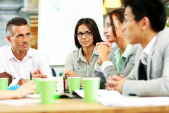 People having meeting around table Stock Photography