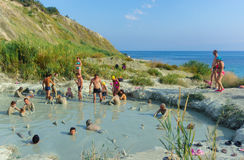People having mud baths of blue clay Royalty Free Stock Photo