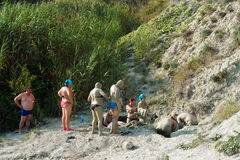 People having mud baths of blue clay Stock Images