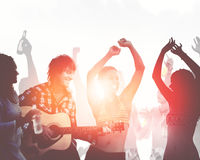 People Having a Party by the Beach Music Dance Concept Royalty Free Stock Image