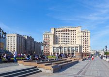 People having a rest on benches on Manezh Square in Moscow Stock Image